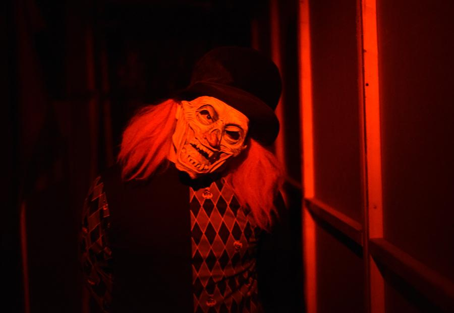"Dalton Gwodzik, of West Frankfort, poses while playing ""Mr. Giggles"" on Saturday, Oct. 22, 2016, at Chittyville School Haunted House in Herrin. Gwodzik has been working at Chittyville School Haunted House for two years and has worked in haunted houses for six years. (Morgan Timms 