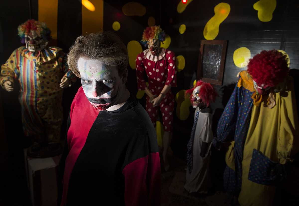 "Patrick Burke, a junior from Los Angeles studying theater, poses for a portrait in the Clown Room on Sunday, Oct. 23, 2016, at Chittyville School Haunted House in Herrin. ""It's fun scaring people,"" he said. (Ryan Michalesko 