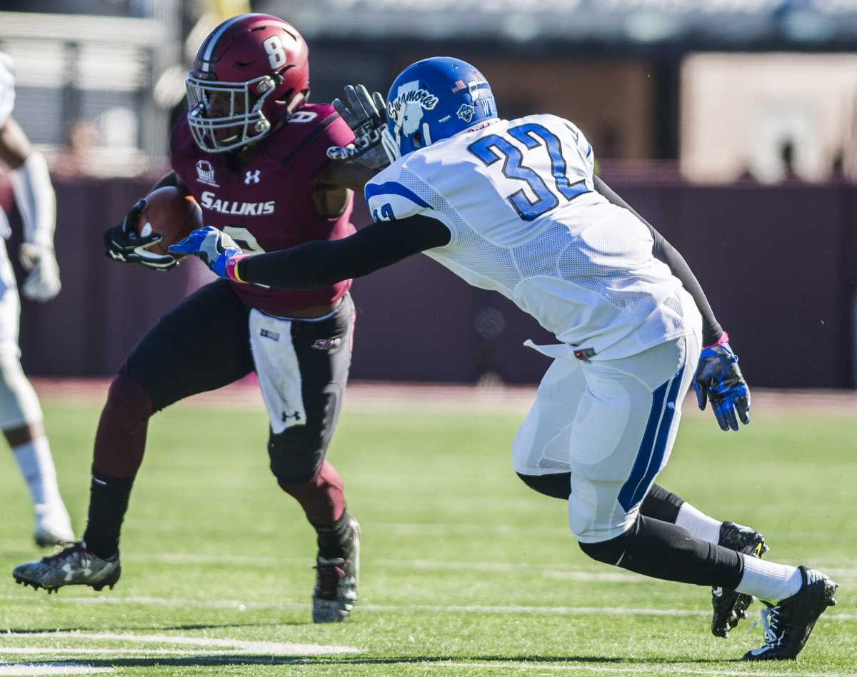 Sophomore wide receiver Darrell James (8) makes a break past Sycamore junior defensive back Brenton Lockett (32) during the Salukis' homecoming match up against the Indiana State Sycamores on Saturday, Oct. 22, 2016, in Carbondale. (Ryan Michalesko | @photosbylesko)