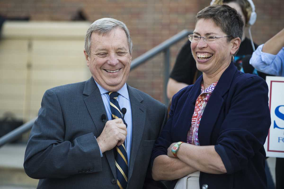 U.S. Sen. Dick Durbin, left, and State Senate candidate Shelia Simon laugh during a Simon campaign stop at Morris Library in Carbondale. (Ryan Michalesko | @photosbylesko)