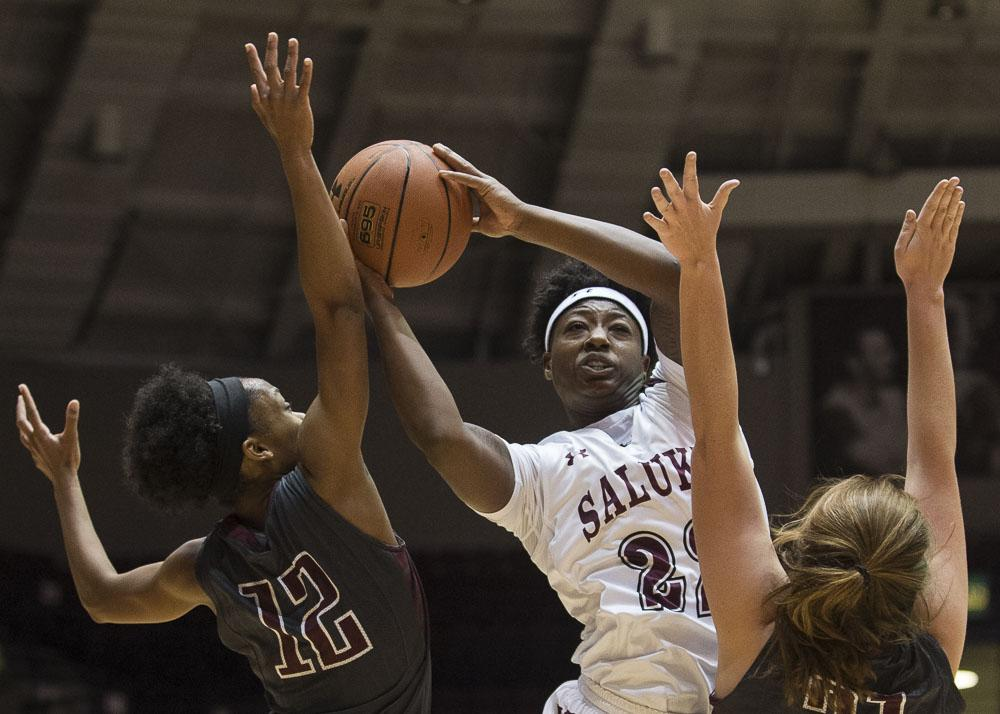 Freshman forward Tiajaney Hawkins (22) puts up a shot over William Woods freshman guard Kaycee Gerald (12) and senior forward Kelsey Scherder (21) during the Salukis' 78-58 win over the William Woods Owls on Thursday, Oct. 27, 2016, at the SIU Arena. (Ryan Michalesko | @photosbylesko)