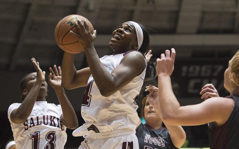 SIU senior forward Kim Nebo (24) puts up a shot during the Salukis' 78-58 win over the William Woods Owls on Thursday, Oct. 27, 2016, at the SIU Arena. (Ryan Michalesko | @photosbylesko)