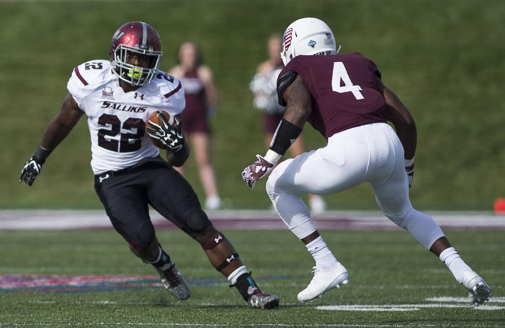 Junior running back Cameron Walter (22) looks to break past Missouri State sophomore cornerback Matt Rush (4) during the Salukis' 38-35 loss to the Missouri State Bears on Saturday, Oct. 29, 2016, in Springfield, Mo. (Ryan Michalesko | @photosbylesko)