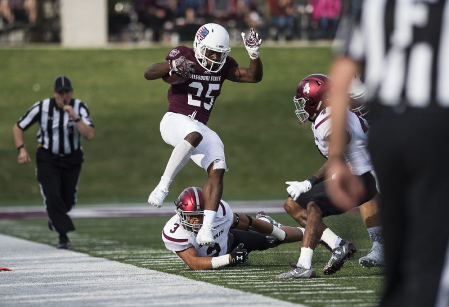 Missouri State sophomore running back Jason Randall (25) is pushed out of bounds by Saluki defense during SIU's 38-35 loss to the Bears on Saturday, Oct. 29, 2016, in Springfield, Mo. (Ryan Michalesko | @photosbylesko)