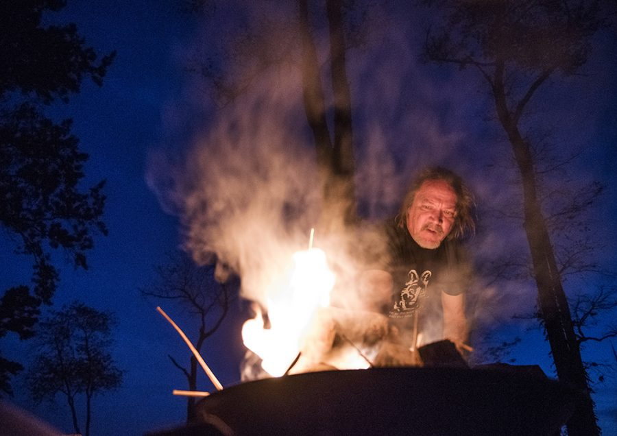 Auto technician and volunteer fire fighter George Cook, of Evansville, throws kindle onto the Spirit Fire on Saturday, Oct. 29, 2016, during the Southern Illinois Pagan Alliance's Samhain celebration at Crab Orchard Campground. Cook has been a member of the alliance for eight years and identifies as an eclectic Pagan.