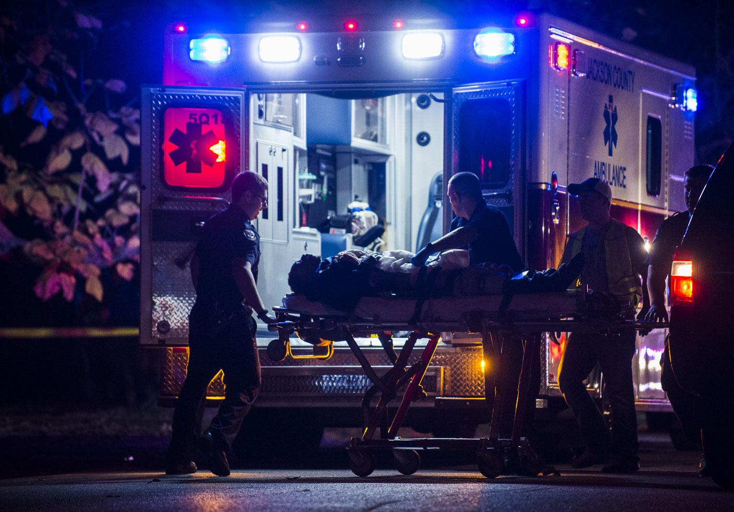 The victim of a stabbing is loaded into an ambulance Sunday, Oct. 30, 2016, in the 600 block of North Michael Street in Carbondale. (Ryan Michalesko | @photosbylesko)