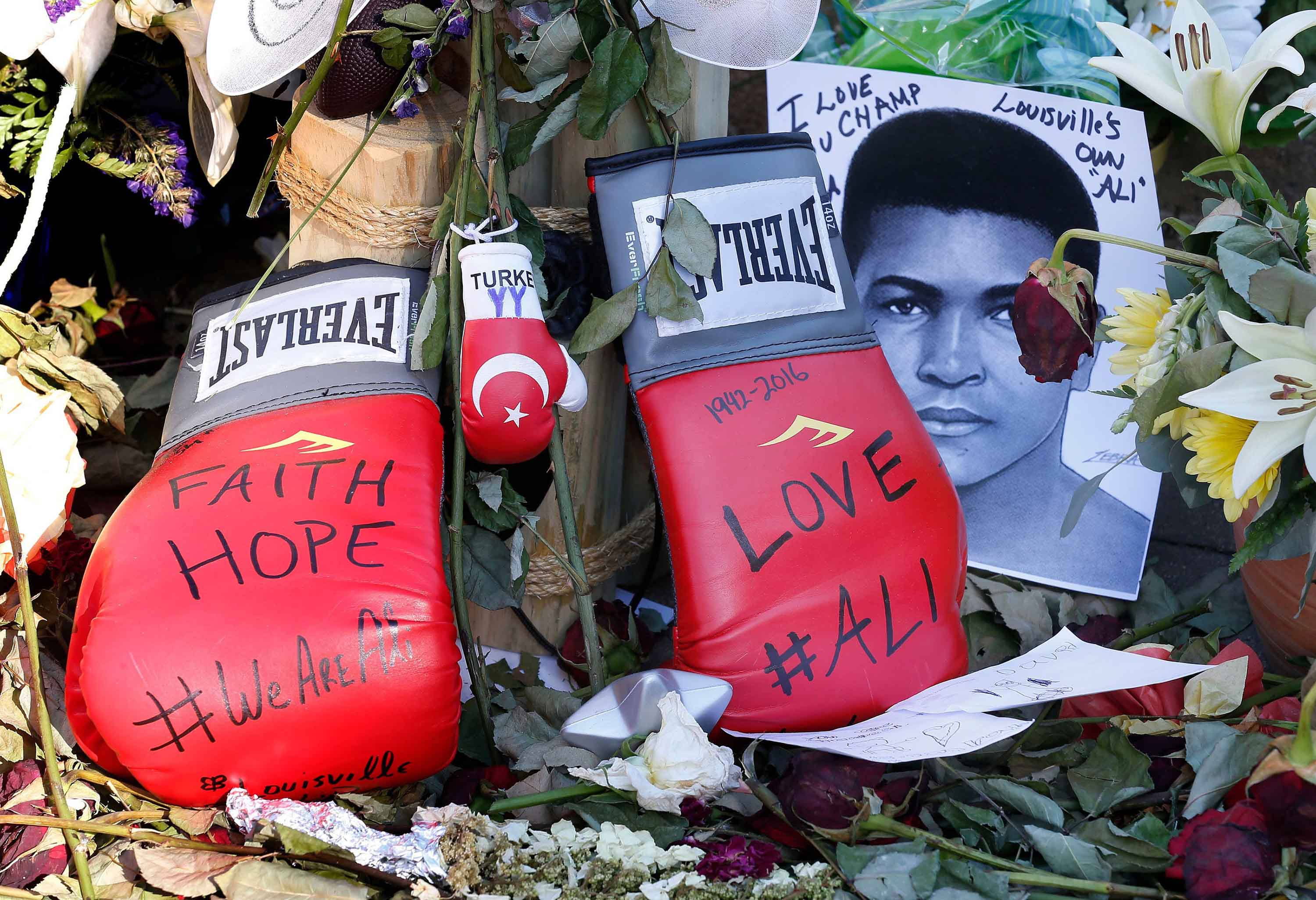 Boxing gloves left at the makeshift memorial at the Muhammed Ali Center in downtown Louisville, Ky., on Friday, June 10, 2016. Ali, a three-time world heavyweight champion, died June 3, 2016, at 74. (Charles Bertram/Lexington Herald-Leader/TNS)