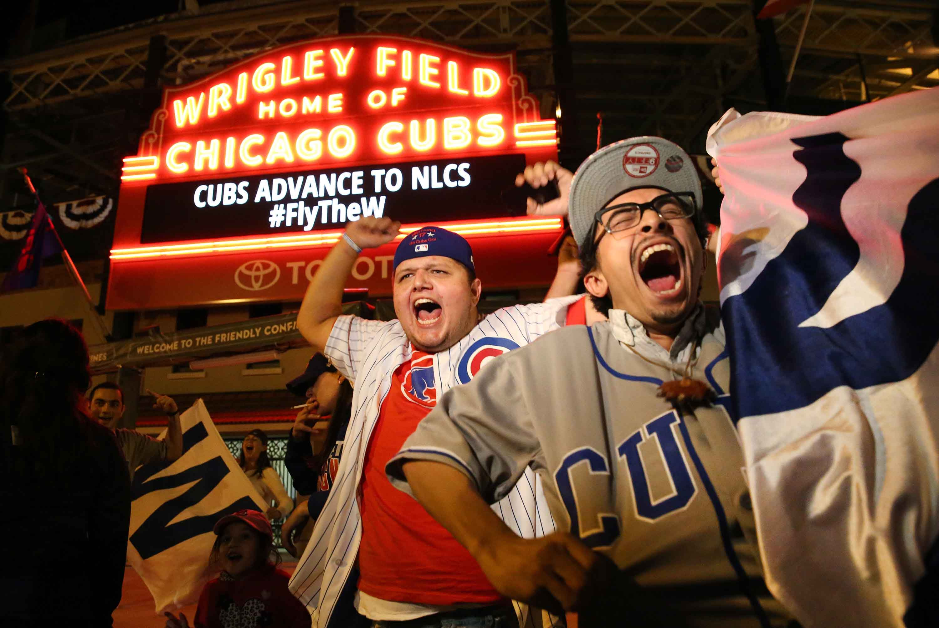 Chicago Cubs fans gather outside Wrigley Field to celebrate the Cubs clinching game 4 of the NLDS series over the San Francisco Giants. on Tuesday, Oct. 11, 2016 in Chicago. (Nuccio DiNuzzo/Chicago Tribune/TNS)