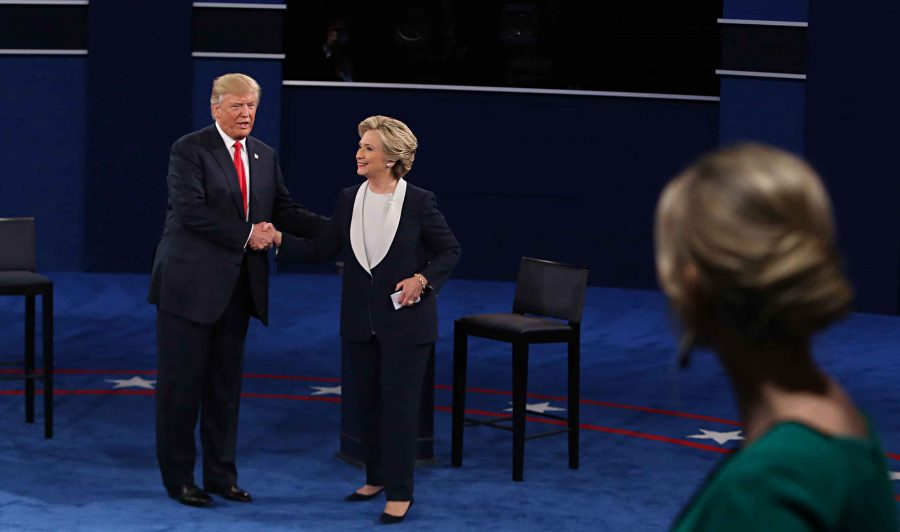 Donald Trump and Hillary Clinton shake hands on stage after the second debate between the Republican and Democratic presidential candidates on Sunday, Oct. 9, 2016 at Washington University in St. Louis, Mo. (Christian Gooden/St. Louis Post-Dispatch/TNS)