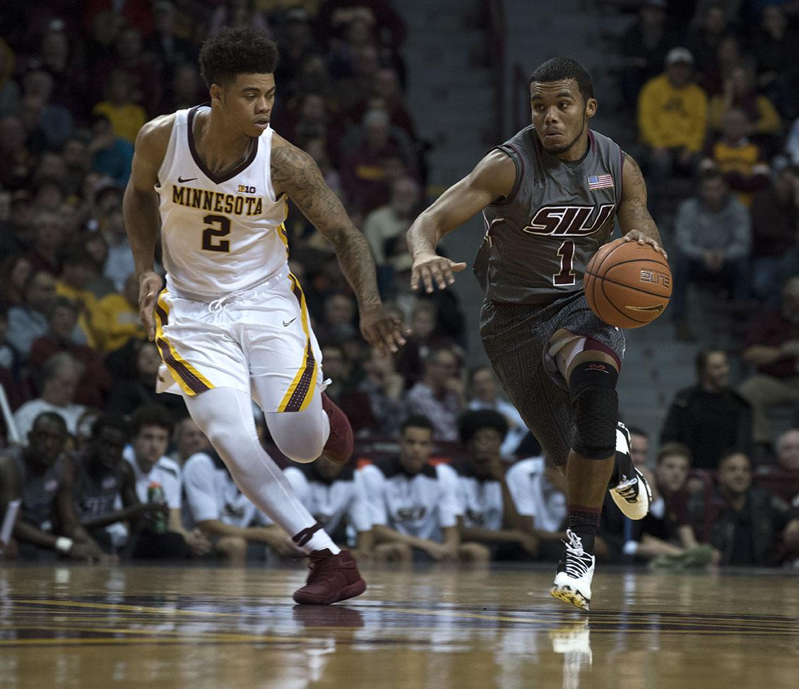 Senior guard Mike Rodriguez charges down the court alongside Minnesota junior guard Nate Mason on Friday, Nov. 25, 2016, during the Salukis' 57-45 loss to the University of Minnesota at Williams Arena in Minneapolis. (Athena Chrysanthou | @Chrysant1Athena)