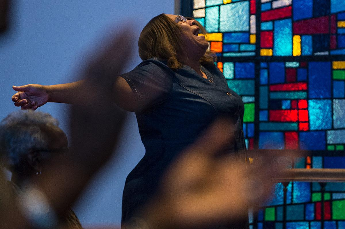 "Tammie Swinney, of Carbondale, participates in a worship service Sunday, Oct. 30, 2016, at Olivet Free Will Baptist Church in Carbondale. ""It's like a family [at Olivet],"" she said. Swinney has been attending Olivet for five and a half years. This year the church celebrates 150 years in the Carbondale community. (Jacob Wiegand 