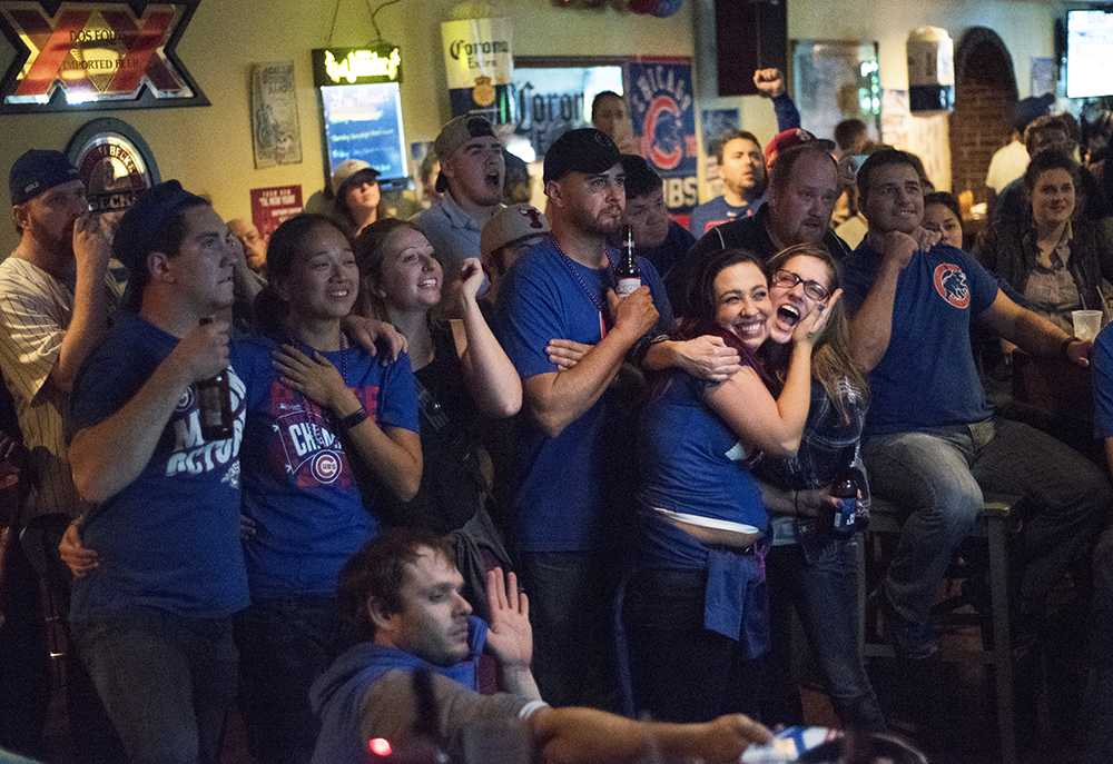 Cubs fans react to a play in the 10th and final inning of the Cubs' World Series-winning game against the Indians on Wednesday, Nov. 2, 2016, at Tres Hombres in Carbondale. The Cubs won the 2016 World Series 4-3, the team's first championships since 1908.
