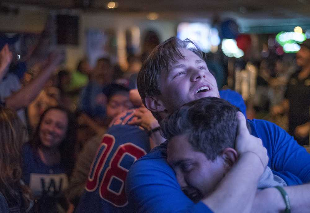 Tristan Workman, of Carbondale, embraces a friend Wednesday, Nov. 2, 2016, while celebrating the Cubs' 2016 World Series championship at Tres Hombres in Carbondale. The Northsiders won the Series 4-3.