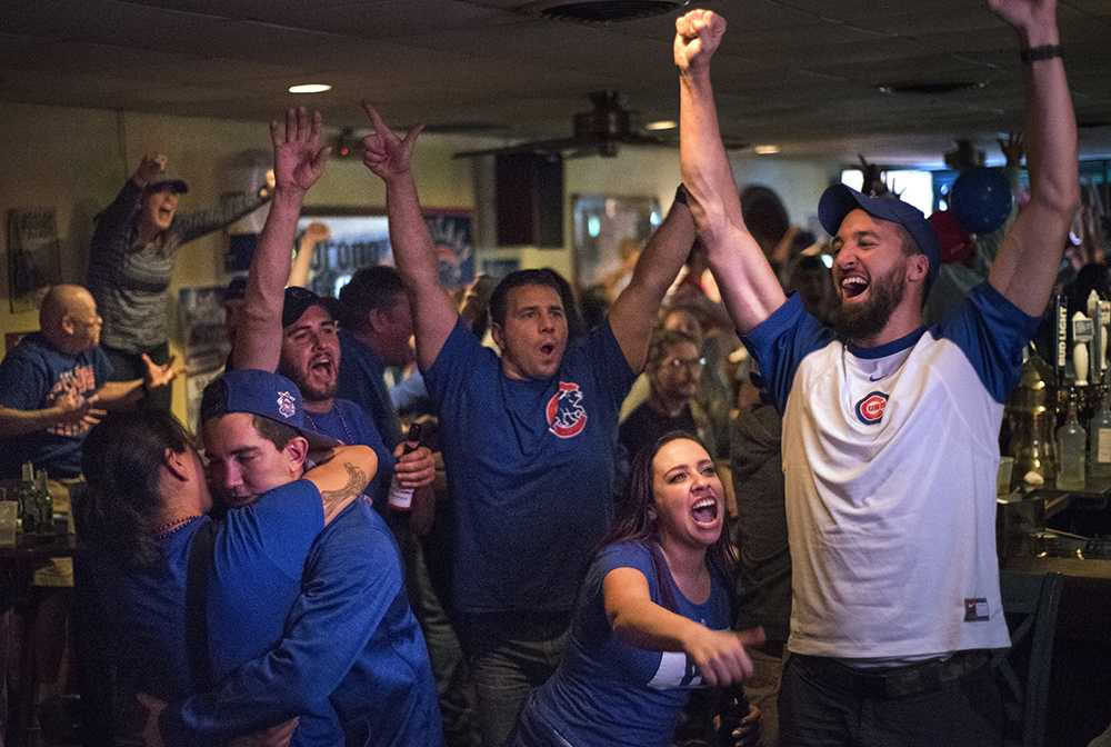 Cubs fans celebrate the team's first World Series championship since 1908 on Wednesday, Nov. 2, 2016, at Tres Hombres in Carbondale. Brittany Ristaino, pictured second from right, said she has been waiting for this moment her whole life.