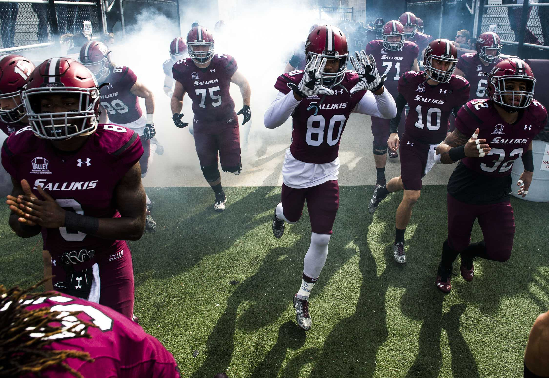 Players burst onto the field Saturday, Nov. 5, 2016, prior to the Salukis' 35-28 win against the University of South Dakota Coyotes at Saluki Stadium. (Ryan Michalesko | @photosbylesko)