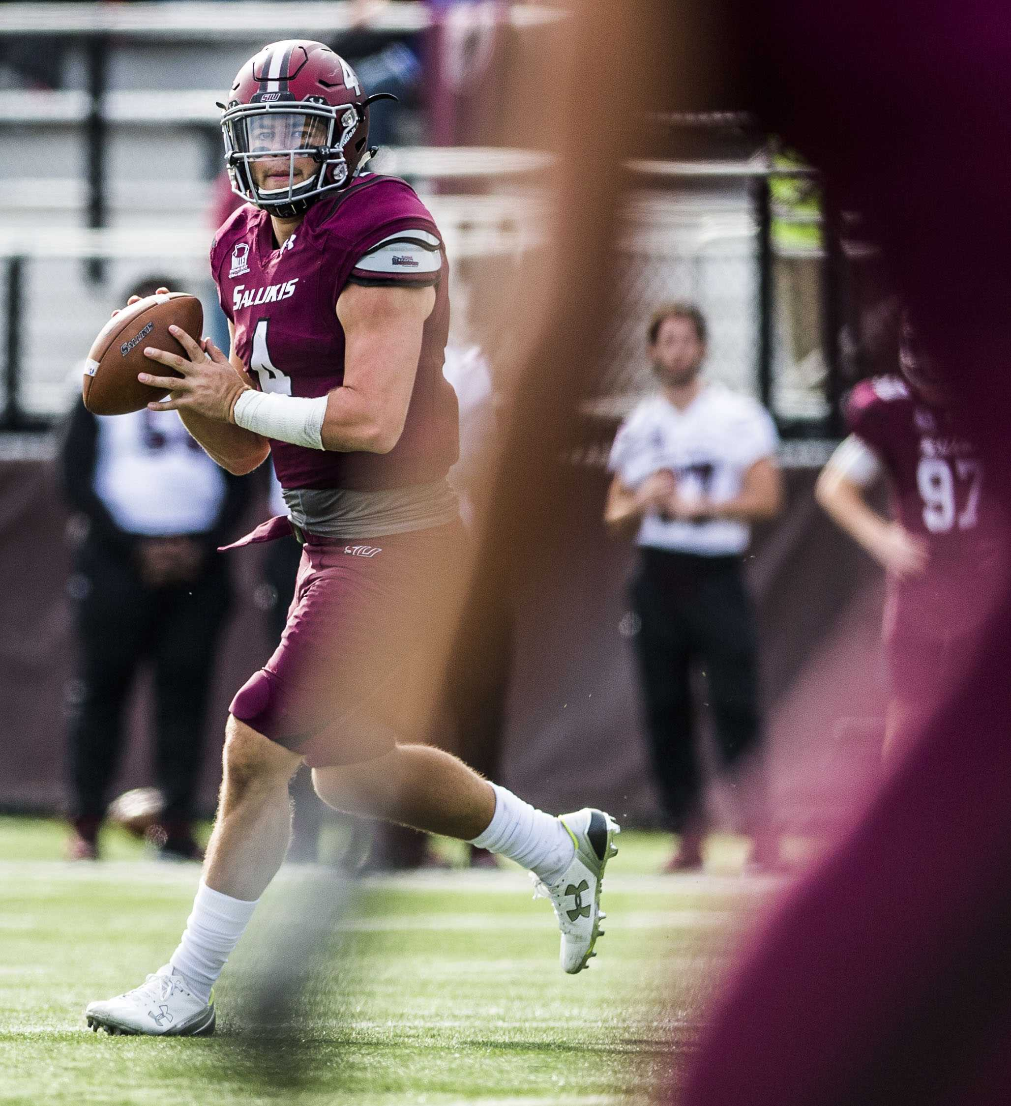 Sophomore quarterback Sam Straub (4) looks to make a pass Saturday, Nov. 5, 2016, during the Salukis' 35-28 win against the University of South Dakota Coyotes at Saluki Stadium. (Ryan Michalesko | @photosbylesko)