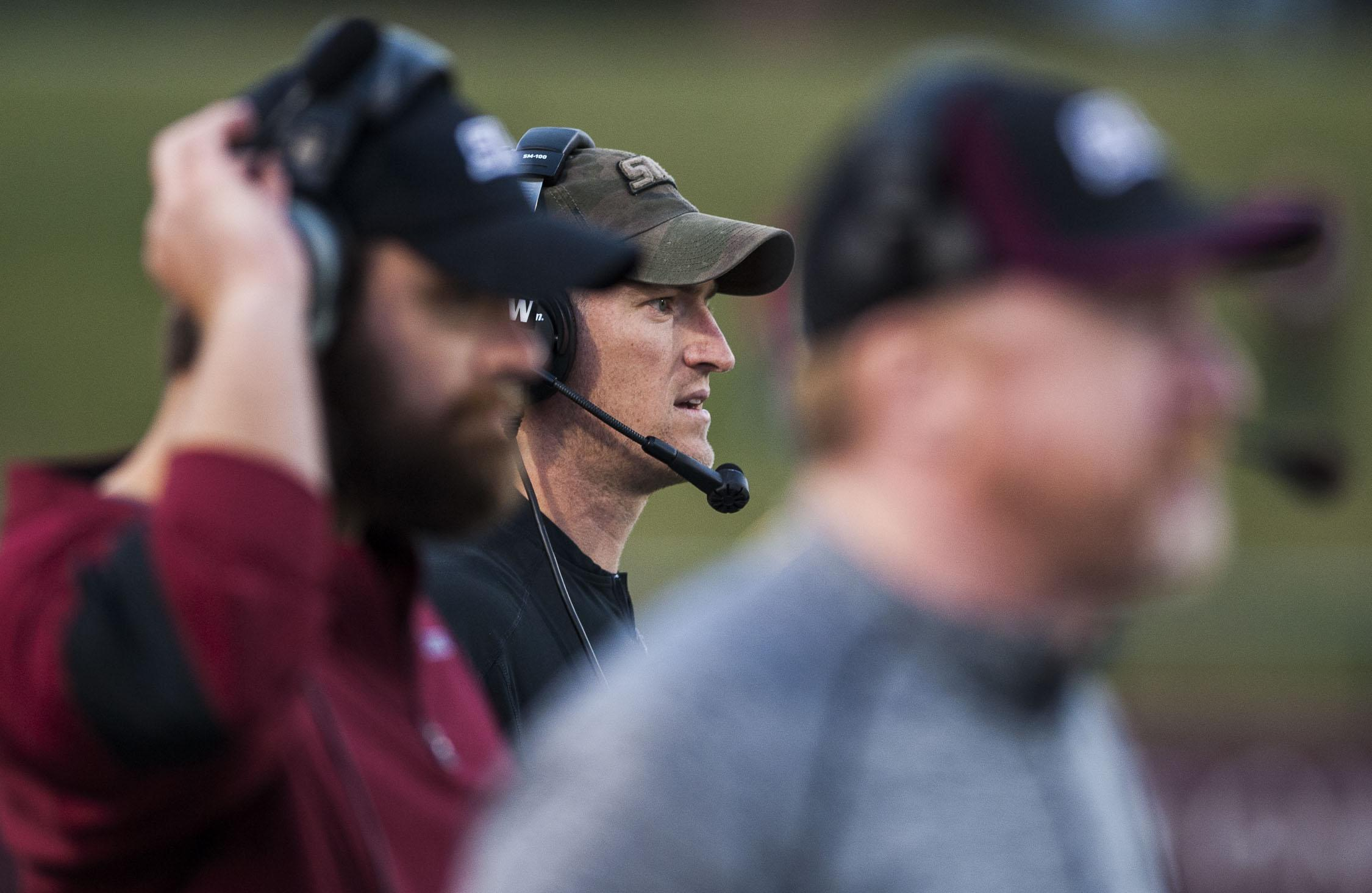 Coach Nick Hill and his coaching staff watch a play Saturday, Nov. 5, 2016, during the Salukis' 35-28 win over the University of South Dakota Coyotes at Saluki Stadium. (Ryan Michalesko | @photosbylesko)