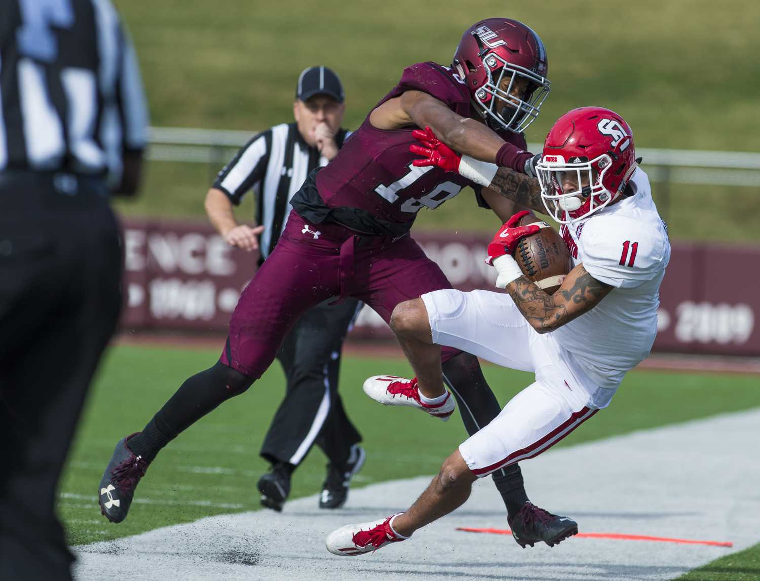Freshman safety Jeremy Chinn (18) forces South Dakota freshman wide receiver Randy Baker out of bounds Saturday, Nov. 5, 2016, during the Salukis' 35-28 win over the University of South Dakota Coyotes at Saluki Stadium. (Ryan Michalesko | @photosbylesko)