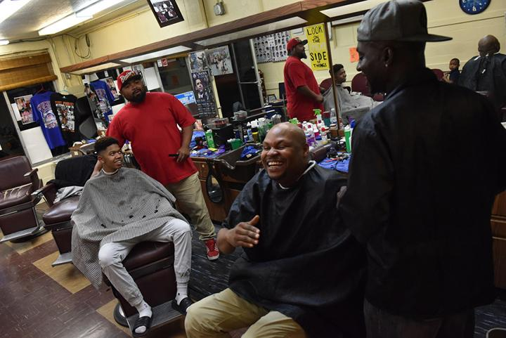 From left to right: DJ Hogan, a senior at Carbondale Community High School, Lee Hughes, Taliq Montegomery and Terrence Upchurch laugh together just before the shop closes up at 8 p.m. on Nov. 2, 2016. (Anna Spoerre | @annaspoerre)