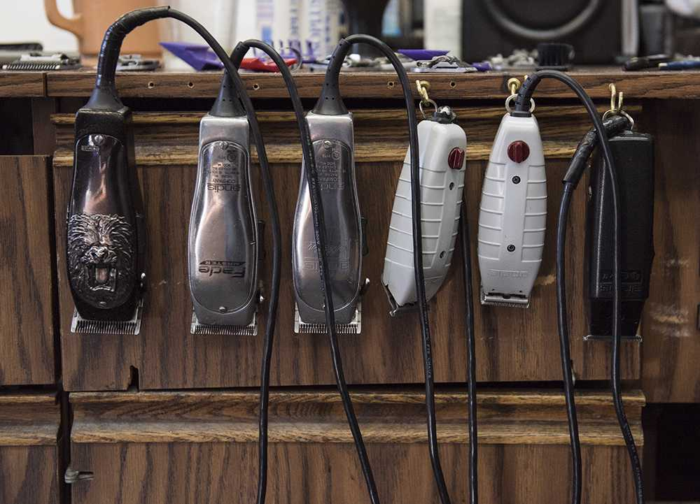 Half a dozen electric razors hang from the side of a cabinet at Arnette's barber shop, which has been open since 1945. (Anna Spoerre | @annaspoerre)