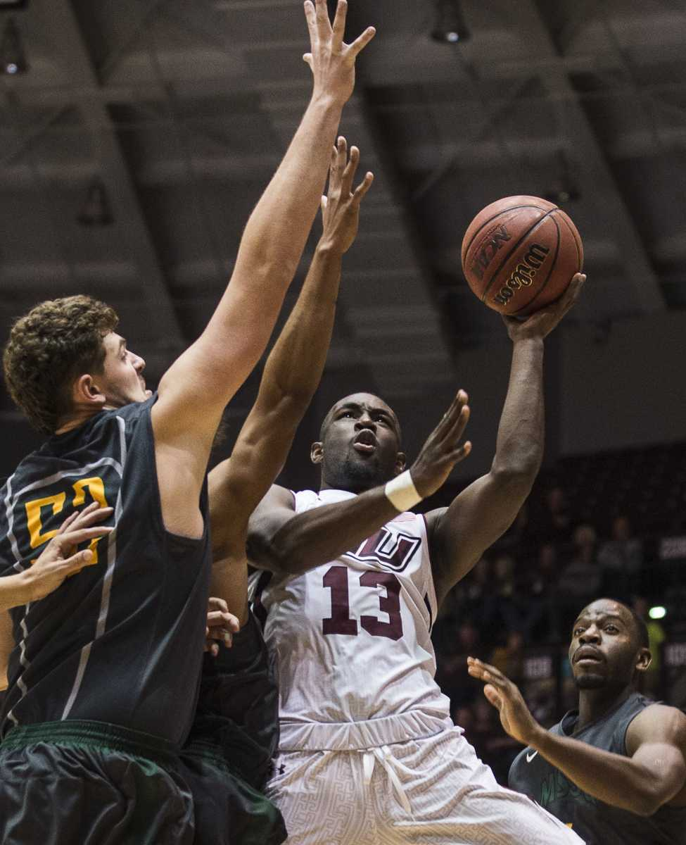 Sophomore guard Sean Lloyd fires up a shot past Missouri Southern freshman center Dexter Frisbie on Wednesday, Nov. 16, 2016, during the Salukis' 85-64 win over the Missouri Southern Lions at SIU Arena. (Ryan Michalesko | @photosbylesko)