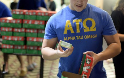 Daniel Bello, a sophomore from Algonquin studying marketing, packs a shoebox with presents Thursday, Nov. 17, 2016, in the Student Center's Old Main room. Bello participated in the charity event Operation Christmas Child, a gift-giving initiative sponsored by the university's chapter of Alpha Tau Omega. (Bill Lukitsch | @lukitsbill)