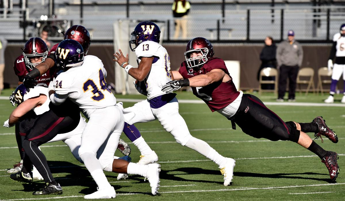 Senior linebacker Chase Allen (5) attempts to tackle WIU sophomore wide receiver Stacey Smith (13) during the Salukis' 44-34 win against Western Illinois on Saturday, Nov. 19, 2016, at Saluki Stadium. (Athena Chrysanthou | @Chrysant1Athena)