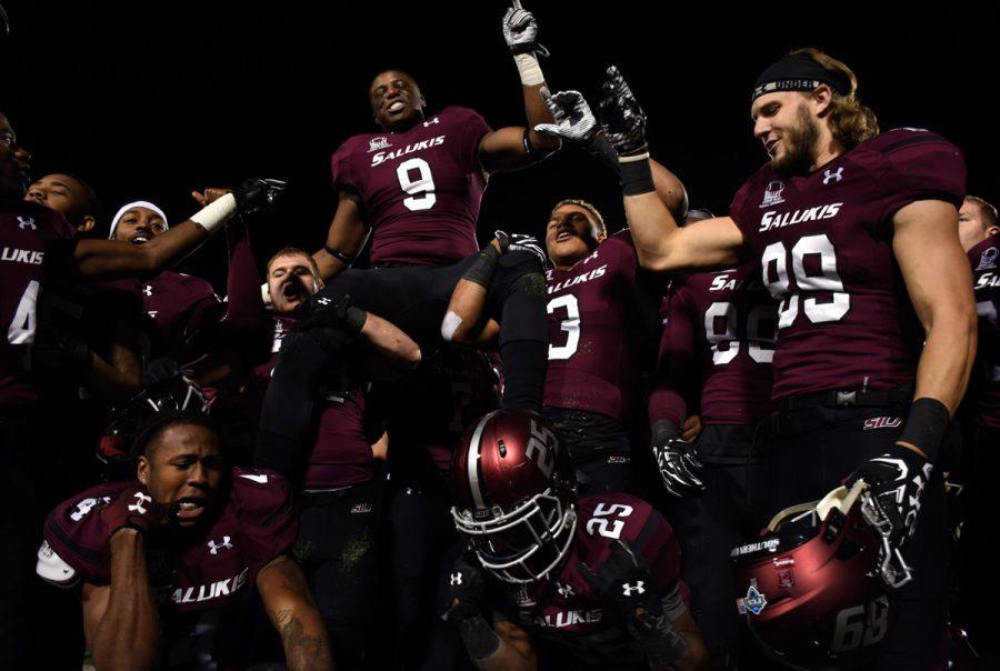 Saluki+football+players+celebrate+after+their+44-34+win+against+Western+Illinois+on+Saturday%2C+Nov.+19%2C+2016%2C+at+Saluki+Stadium.+%28Athena+Chrysanthou+%7C+%40Chrysant1Athena%29