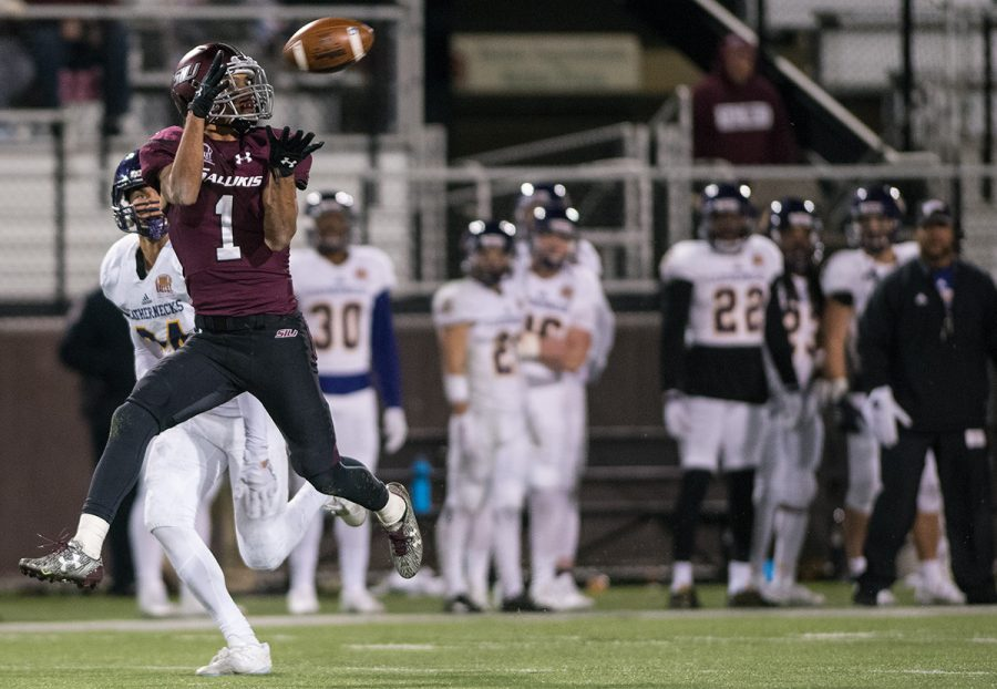 Saluki+senior+wide+receiver+Israel+Lamprakes+catches+the+ball+as+Leatherneck+freshman+defensive+back+Mike+Viti+prepares+to+attempt+a+tackle+near+the+conclusion+of+SIU%27s+44-34+win+against+WIU+on+Saturday%2C+Nov.+19%2C+2016%2C+at+Saluki+Stadium.+%28Jacob+Wiegand+%7C+%40jawiegandphoto%29+