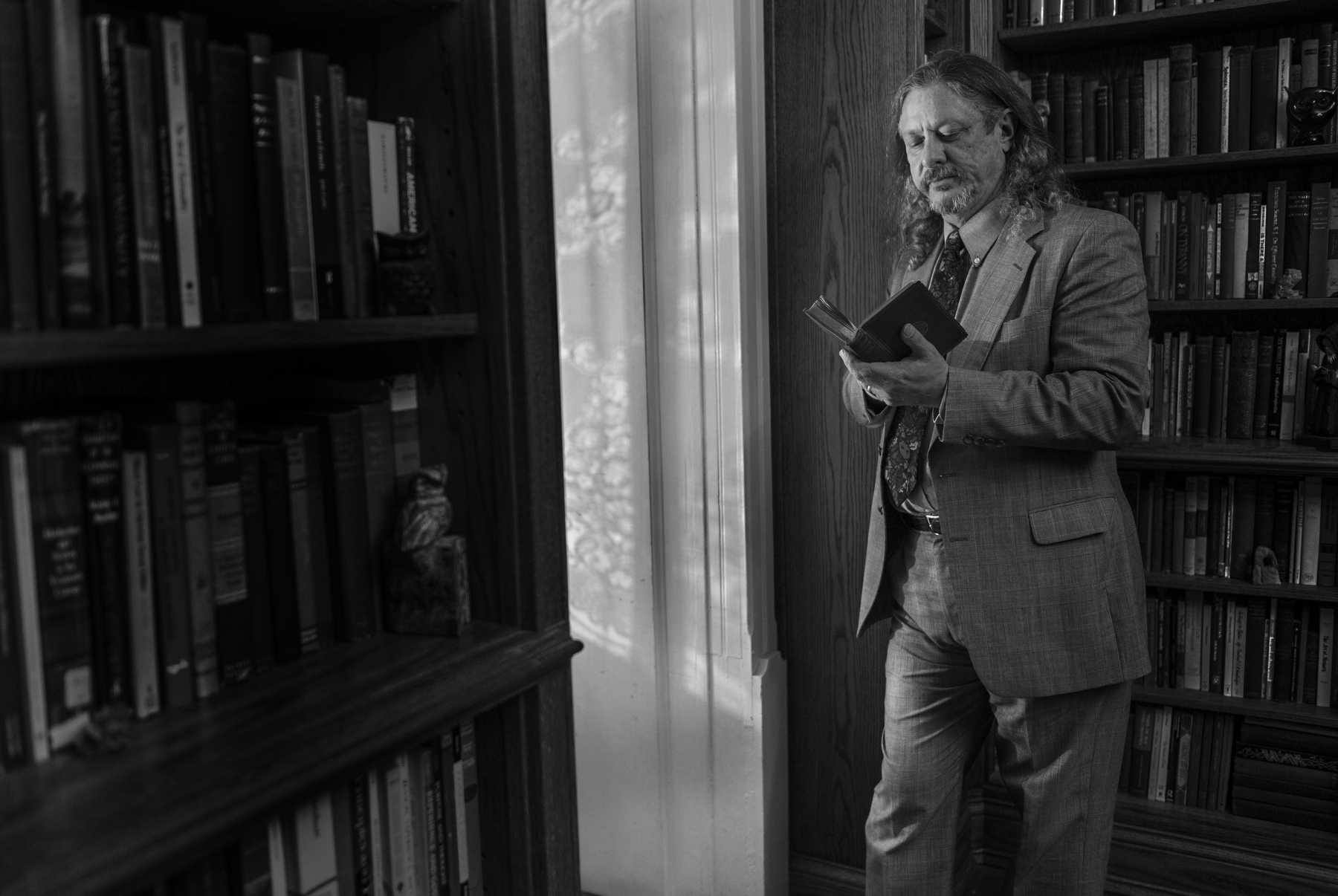 Professor of philosophy Randall Auxier poses for a portrait Monday, Nov. 21, 2016, in his Murphysboro home prior to its opening ceremony as the American Institute for Philosophical and Cultural Thought. The institute, which houses an estimated 35,000 books and scholarly articles, was established as a research site for humanities students in response to the closure of SIU's Center for Dewey Studies.