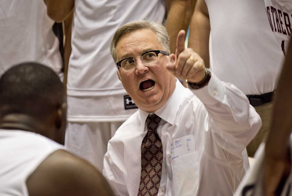 SIU coach Barry Hinson addresses players during the Salukis' 73-63 win over Mount St. Mary University on Monday, Nov. 21, 2016, at SIU Arena. (Athena Chrysanthou | @Chrysant1Athena)