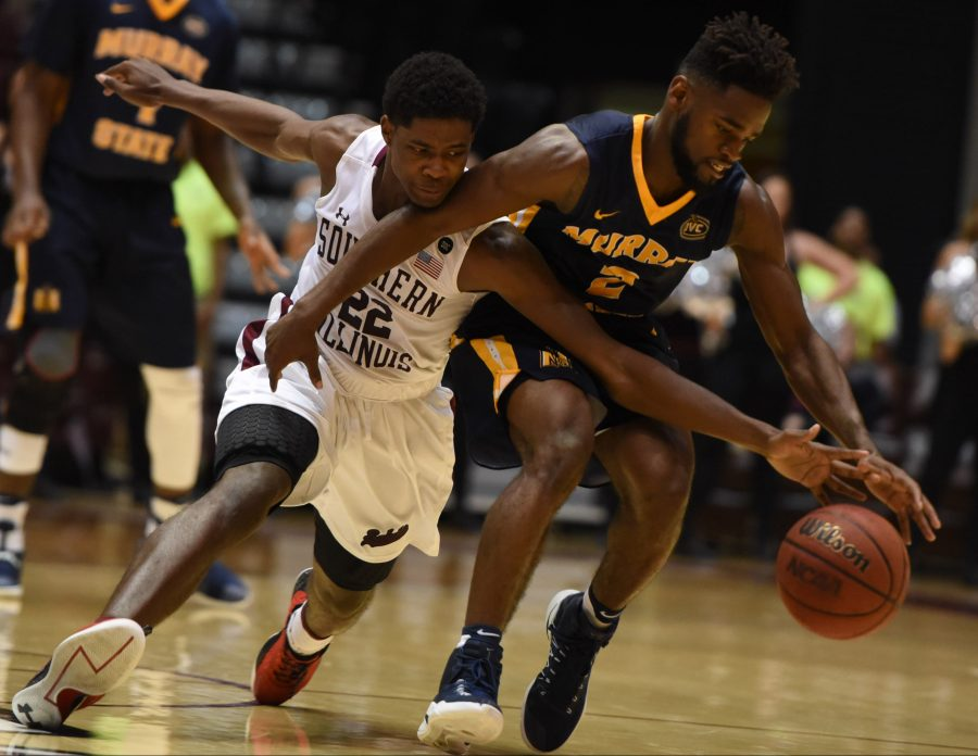 Saluki sophomore guard Armon Fletcher and Racer junior guard Jonathan Stark race for a loose ball Tuesday, Nov. 29, 2016, during SIU's 89-85 overtime win against Murray State at SIU Arena. (Bill Lukitsch | @lukitsbill)