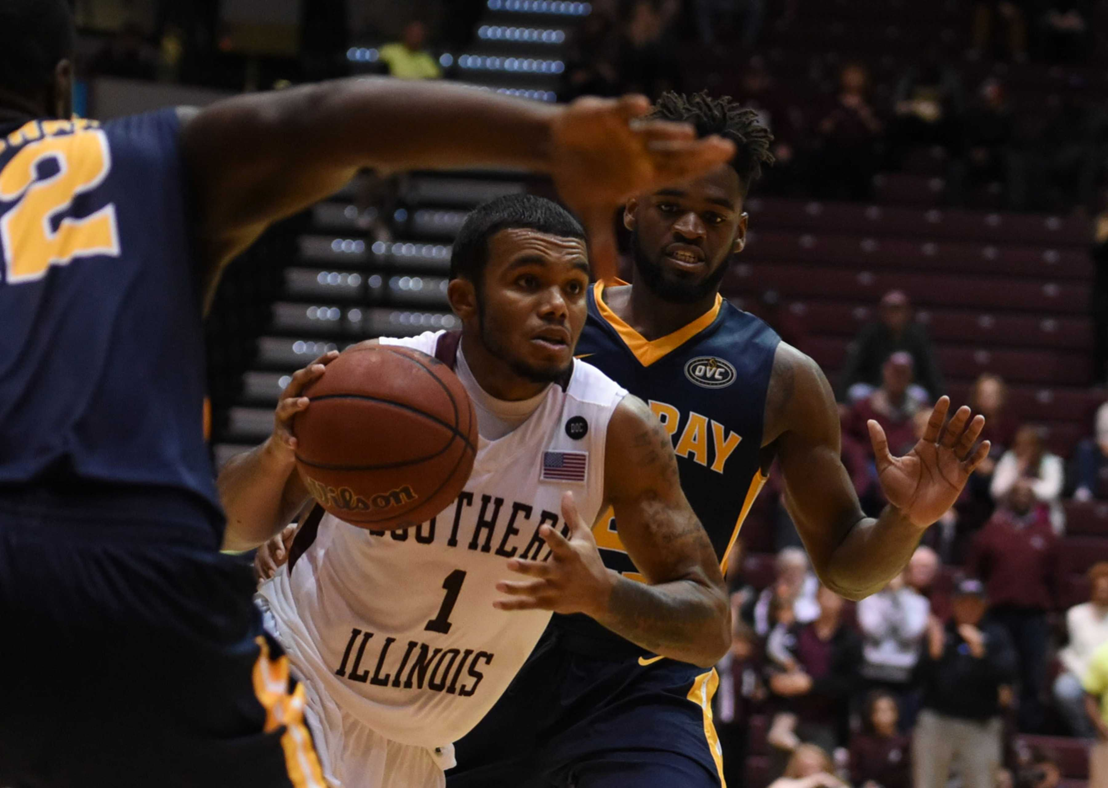 Senior guard Mike Rodriguez drives toward the basket as he is guarded by senior guard Gee McGhee, left, and junior guard Jonathan Stark on Tuesday, Nov. 29, 2016, during SIU's 89-85 overtime win against Murray State at SIU Arena. (Bill Lukitsch | @lukitsbill)