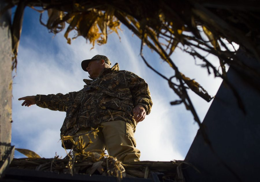 """Henry C. Ruth III, of Springfield, Tenn., points to another hunting group Wednesday, Nov. 30, 2016, during a Wounded Warriors duck hunt at Grassy Lake Hunting Club in Jonesboro. """"I think it's very healing for those who are wounded to come out and be with their own soldiers that are just like them,"""" said Ruth, who retired from the Army after 28 years of service. """"Being able to do that makes them normal."""" (Ryan Michalesko 