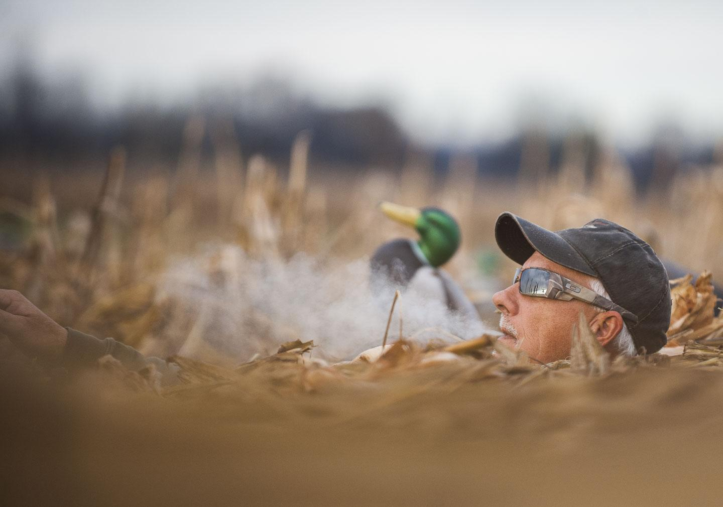 Grassy Lake Hunting Club guide Duane Smith smokes a cigarette while watching for incoming ducks Wednesday, Nov. 30, 2016, during a Wounded Warriors duck hunt in Jonesboro. (Ryan Michalesko   @photosbylesko)