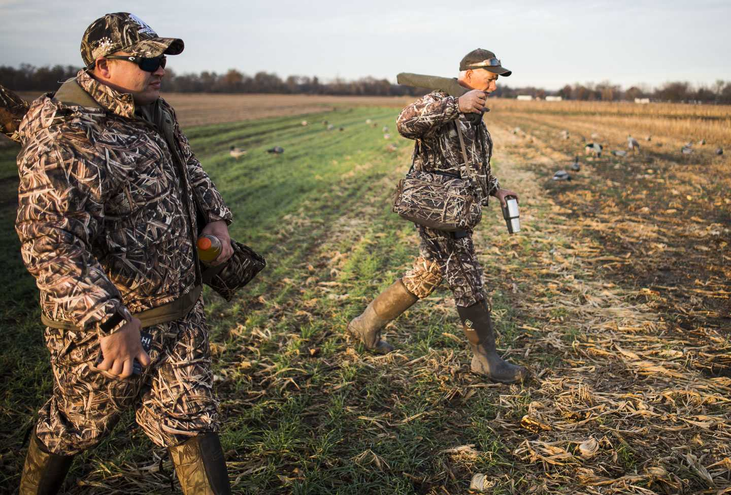 Grassy Lake Hunting Club guide Duane Smith, right, and John Thomas, of Nashville, Tenn., make their way to a hunting blind Wednesday, Nov. 30, 2016, during a Wounded Warriors duck hunt in Jonesboro. (Ryan Michalesko | @photosbylesko)