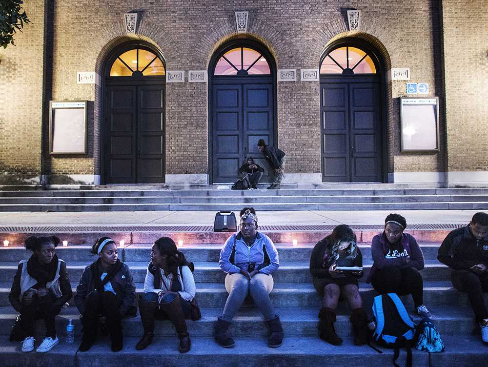 Asia Lee, a masters student in business administration from Chicago, speaks to Lamont Blackman, a senior from Chicago studying aviation, while students gather on the steps of Shryock Auditorium on Wednesday, Nov. 9, 2016, before a group reflection with Rev. Joseph Brown in response to Donald Trump's presidency. The reflection began with a performance of Amazing Grace and ended with speeches from Brown and Lee.