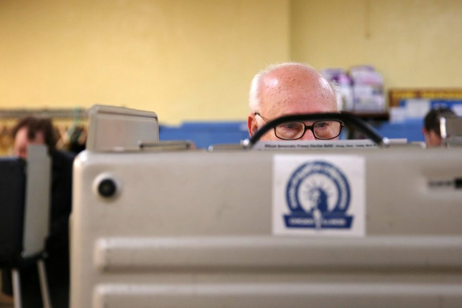Hector Hernandez of Andersonville looks over the ballot Tuesday, March 15, 2016 at the Ebenezer Lutheran Church in the 1600 block of West Foster Avenue in Chicago, Ill. (Anthony Souffle/Chicago Tribune/TNS)