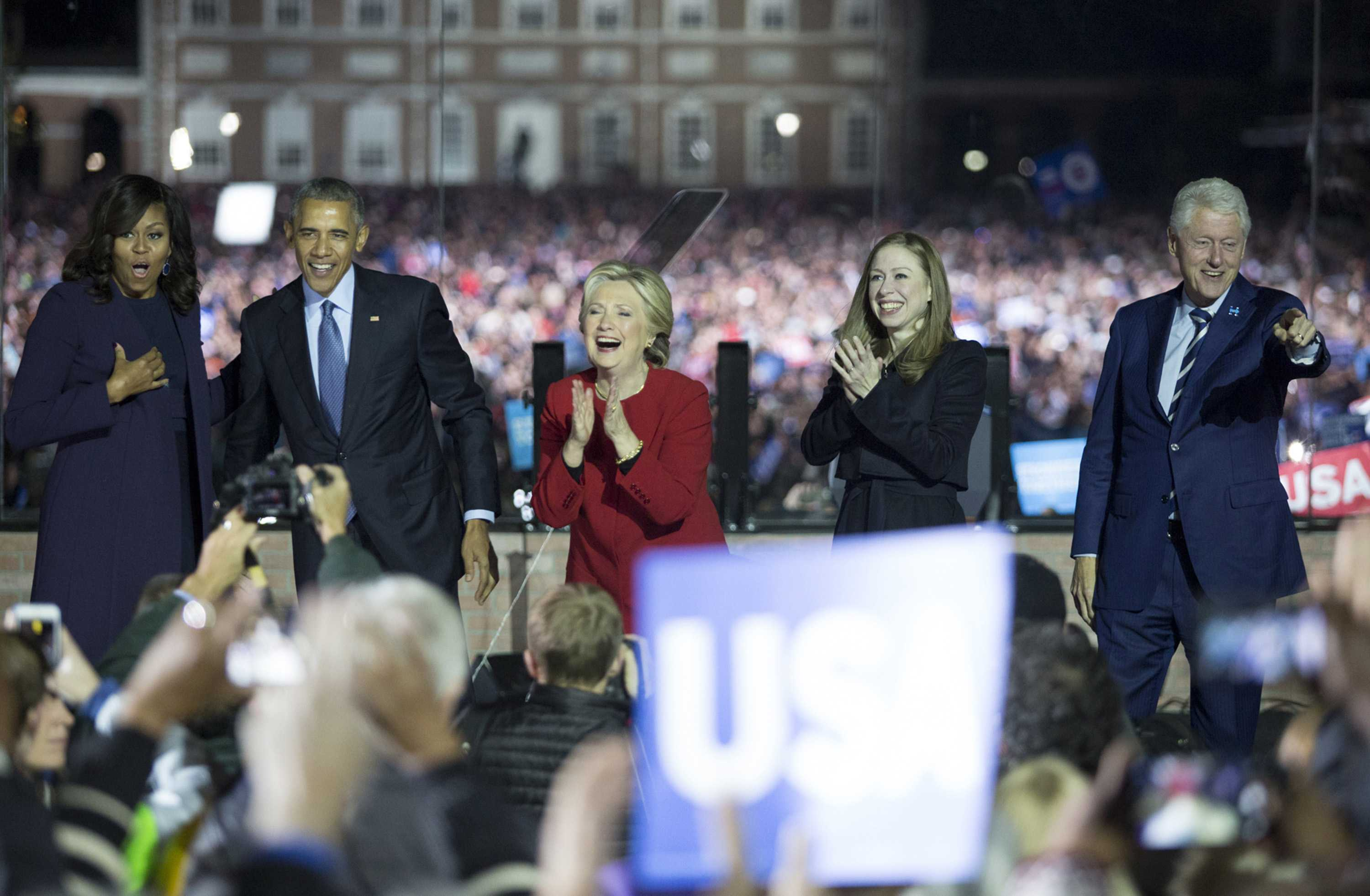 Barack and Michelle Obama along with Hillary, Bill and Chelsea Clinton look out over a crowd in Philadelphia during a rally for Hillary Clinton's presidency on the evening before the election on Monday, Nov. 7, 2016 in Philadelphia, Pa. (Margo Reed/Philadelphia Inquirer/TNS)