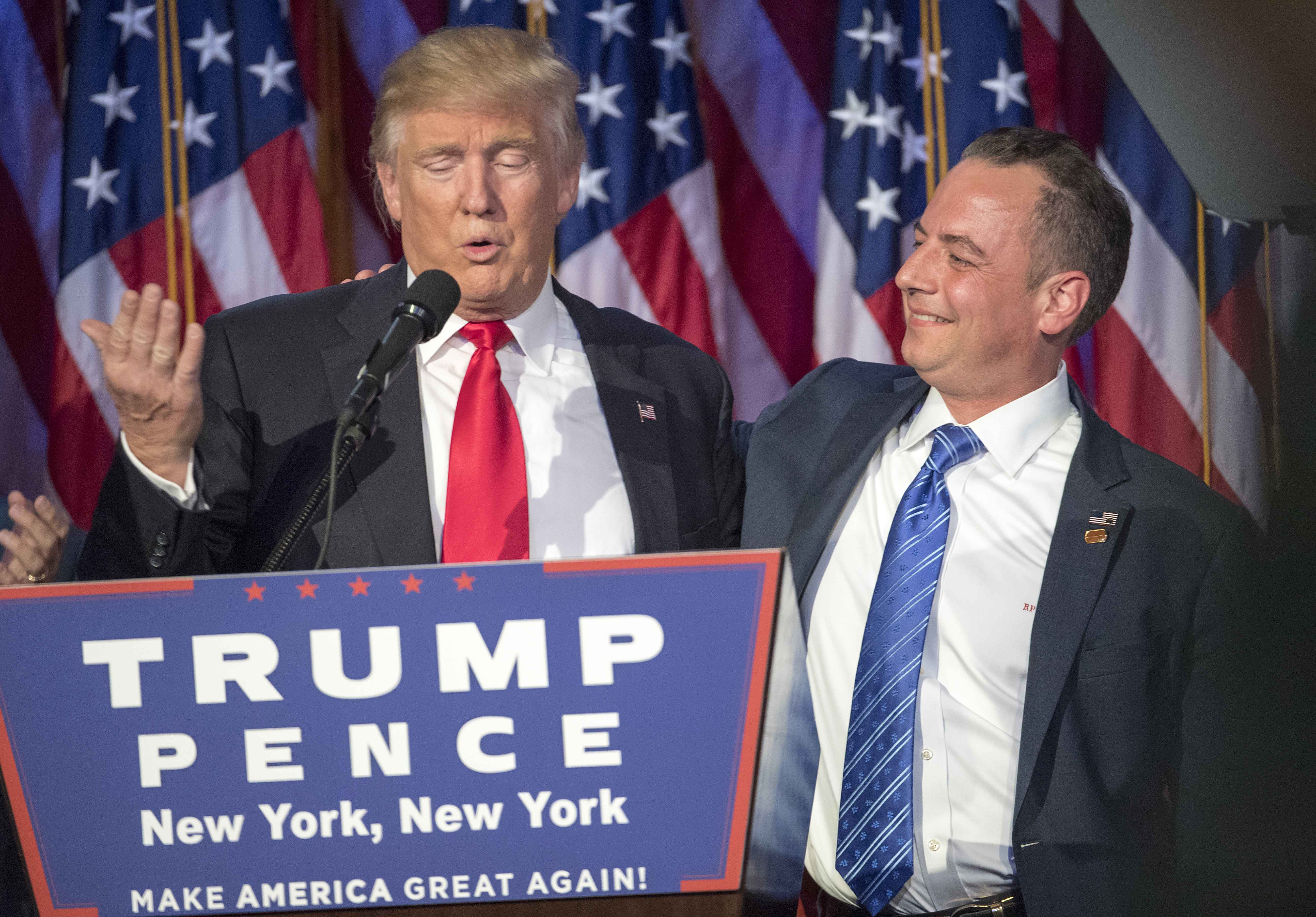 President-elect Donald Trump acknowledges the chairman of the RNC, Reince Priebus, while talking to supporters at the Election Night Party at the Hilton Midtown Hotel in New York City on Wednesday, Nov. 9, 2016. (J. Conrad Williams Jr./Newsday/TNS)