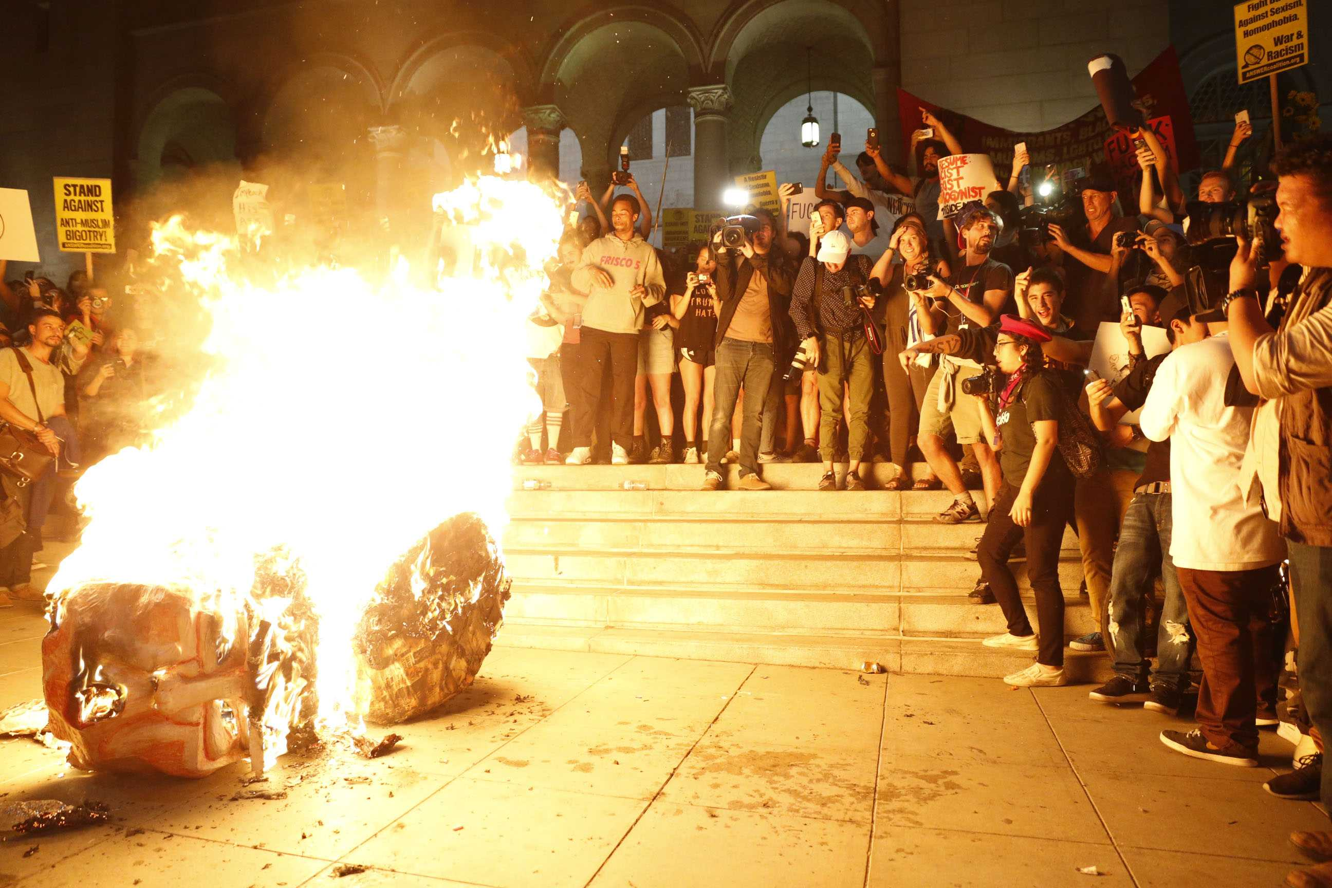 Protesters burn an effigy of Donald Trump outside Los Angeles City Hall on Wednesday, Nov. 9, 2016. (Marcus Yam/Los Angeles Times/TNS)