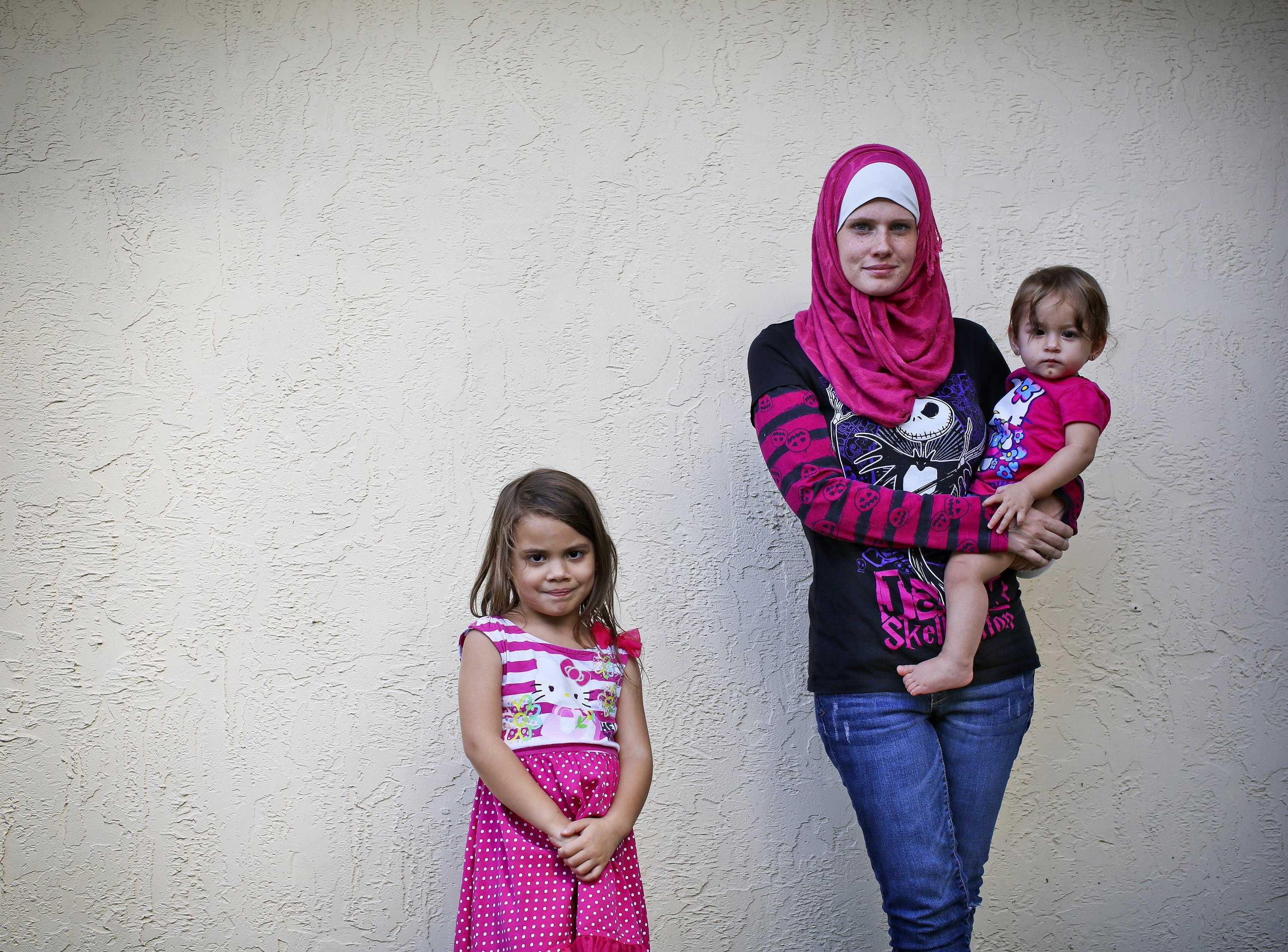 Rose Garcia-Corrigan and her daughters A'isha, left 4, and Tziphorah, 1, at their Kissimmee, Florida, home on Oct. 31, 2013. Rose, a Muslim, believes that she was the victim of a hate crime after another driver tried to run her off of the road while mocking her head scarf. (Jacob Langston/Orlando Sentinel/MCT)