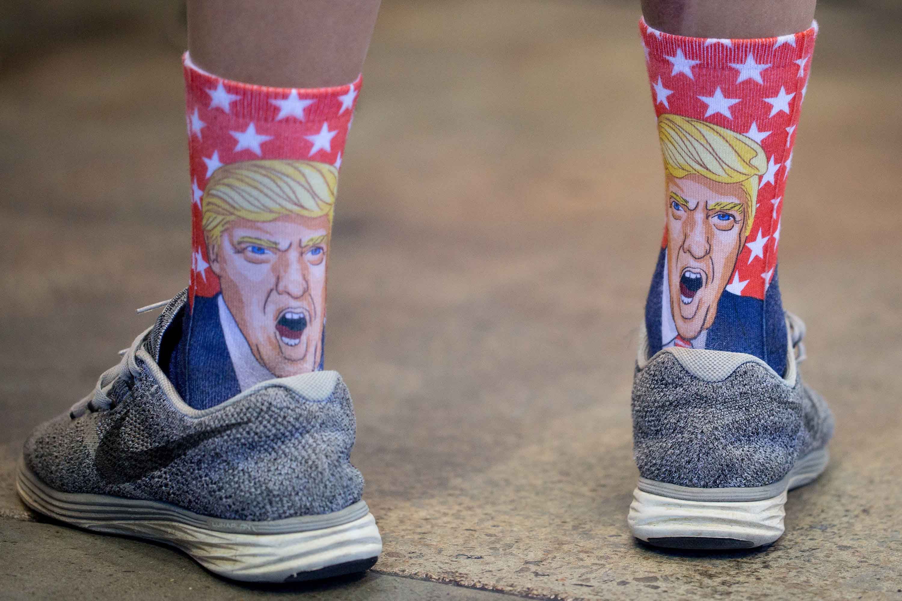 A supporter sports Donald Trump socks prior to the Republican candidate's campaign stop at Dorton Arena Monday, Nov. 7, 2016 in Raleigh N.C. It's the final day before Election Day. (Jill Knight/Raleigh News & Observer/TNS)