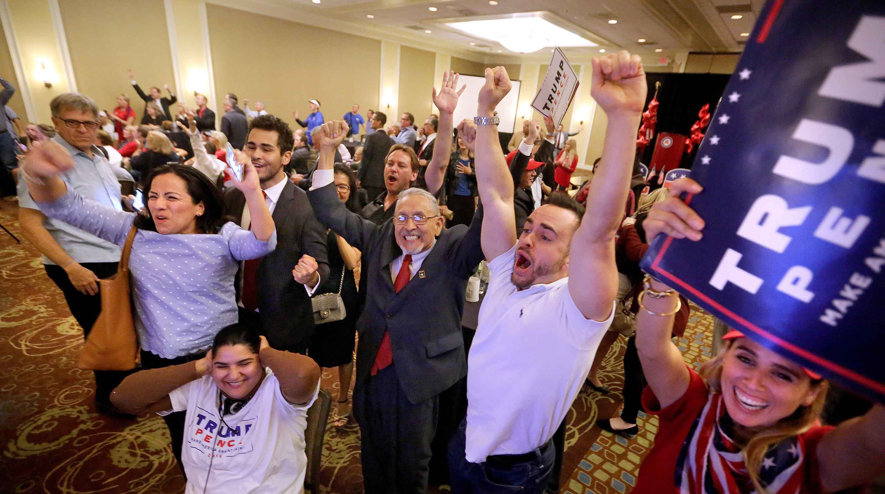 Donald Trump supporters react as Fox News predicted Trump will win North Carolina at the Republican Party of Seminole County, Fla. (Joe Burbank/Orlando Sentinel/TNS)