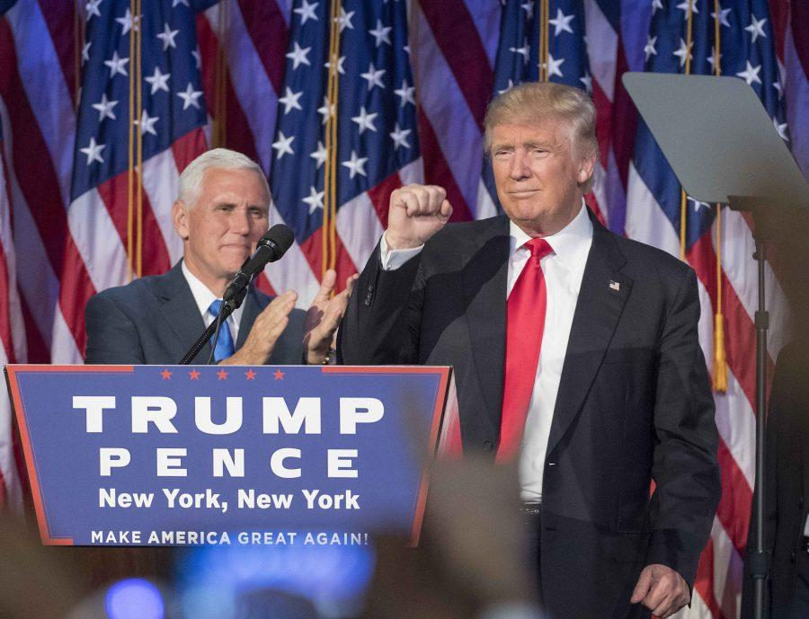 President-elect Donald Trump pumps his fist, with running mate Mike Pence standing by, following a speech to his supporters after winning the election at  the Election Night Party at the Hilton Midtown Hotel in New York City on Wednesday, Nov. 9, 2016. (J. Conrad Williams Jr./Newsday/TNS)