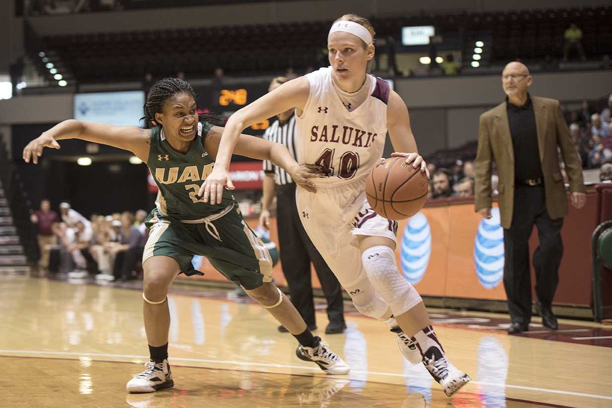 Senior guard Carlie Corrigan looks to pass around University of Alabama at Birmingham junior guard Whytney Singleton during the Salukis' 64-49 loss to the Blazers on Saturday, Dec. 3, 2016, at SIU Arena. (Daily Egyptian file photo)
