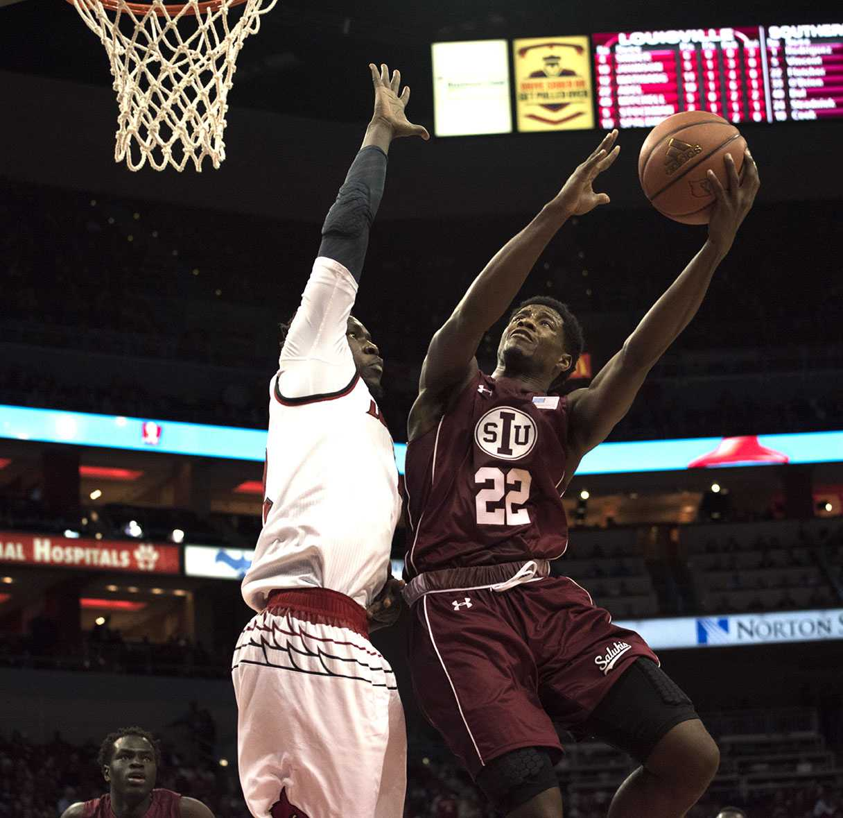 Sophomore guard Armon Fletcher attempts a layup Wednesday, Dec. 7, 2016, during the Salukis' 74-51 loss to the Cardinals at the KFC Yum! Center in Louisville, Ky. (Athena Chrysanthou | @Chrysant1Athena)