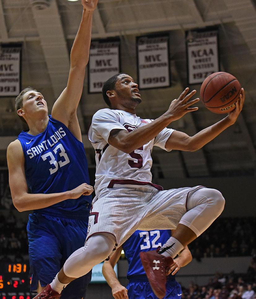 Senior guard Leo Vincent looks to shoot a basket past Saint Louis freshman forward Elliott Welmer on Wednesday, Dec. 14, 2016, during the Salukis' 70-55 win against the Billikens at SIU Arena. (Athena Chrysanthou | @Chrysant1Athena)