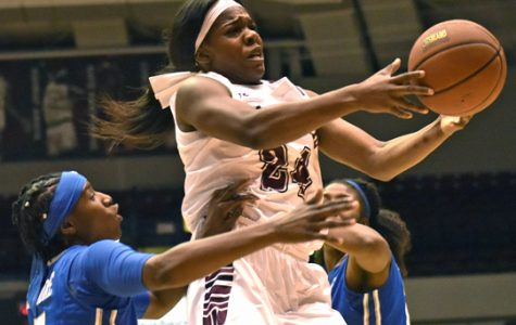 Senior forward Kim Nebo attempts to shoot a basket Sunday, Dec. 11, 2016, during the Salukis' 69-61 win against Memphis at SIU Arena. (Athena Chrysanthou | @Chrysant1Athena)