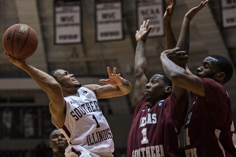 Senior guard Mike Rodriguez goes up for a basket while being guard by Texas Southern junior guard Jalan McCloud and graduate center Marvin Jones during the Salukis' 74-70 win over the Tigers on Saturday, Dec. 3, 2016, at SIU Arena. (Jacob Wiegand | @jawiegandphoto)